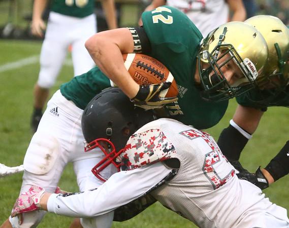 9-8-17<br /> Eastern vs Taylor football<br /> Eastern's Tytus Morrisett tries to get by Taylor's Hunter Forrey.<br /> Kelly Lafferty Gerber | Kokomo Tribune