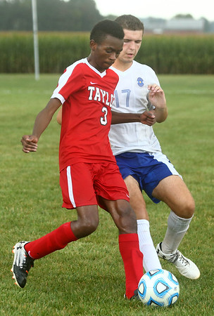 9-19-17<br /> Tri Central vs Taylor boys soccer<br /> Taylor's Jaylin Reece and TC's Nathan Mast go after the ball.<br /> Kelly Lafferty Gerber | Kokomo Tribune