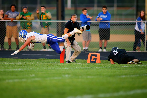 Tipton's first touchdown comes from Sebastian Connor with a dive over the line after being tripped up by Western's Nick Hackler in Friday night's football between Western HS and Tipton HS on Sept. 15, 2017. <br /> Tim Bath   Kokomo Tribune