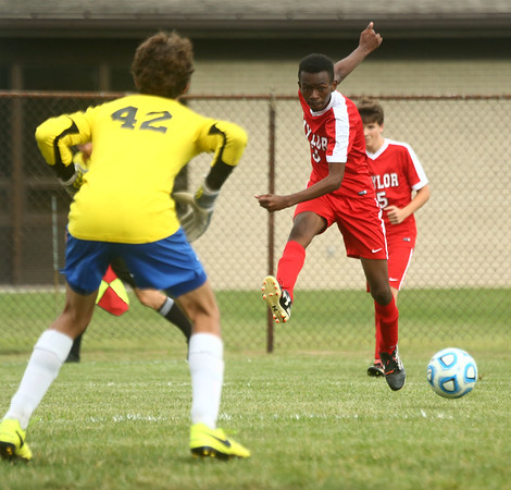 9-19-17<br /> Tri Central vs Taylor boys soccer<br /> Taylor's Jaylin Reece kicks.<br /> Kelly Lafferty Gerber | Kokomo Tribune