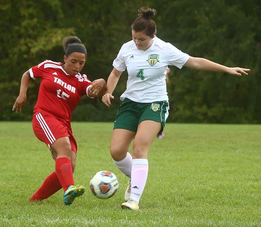 9-27-17<br /> Eastern vs Taylor girls soccer<br /> Taylor's Kiki Miller and Eastern's Jordan Secrease.<br /> Kelly Lafferty Gerber   Kokomo Tribune