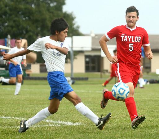 9-19-17<br /> Tri Central vs Taylor boys soccer<br /> TC's Carlos Avelino kicks.<br /> Kelly Lafferty Gerber | Kokomo Tribune