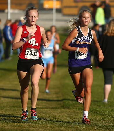 9-9-17<br /> Girls and boys cross country at Maconaquah<br /> NW's Lauren Longshore (right).<br /> Kelly Lafferty Gerber   Kokomo Tribune