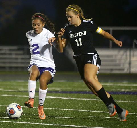 9-14-17<br /> Northwestern vs Western girls soccer<br /> NW's Sasha Jocius and Western's Hannah Granfield go after the ball.<br /> Kelly Lafferty Gerber | Kokomo Tribune