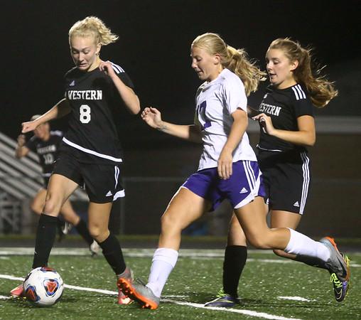 9-14-17<br /> Northwestern vs Western girls soccer<br /> Western's Grace Sullivan regains control of the ball over NW's Olivia Hale.<br /> Kelly Lafferty Gerber | Kokomo Tribune