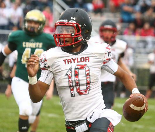 9-8-17<br /> Eastern vs Taylor football<br /> Taylor's Peyton Johnson runs the ball.<br /> Kelly Lafferty Gerber | Kokomo Tribune