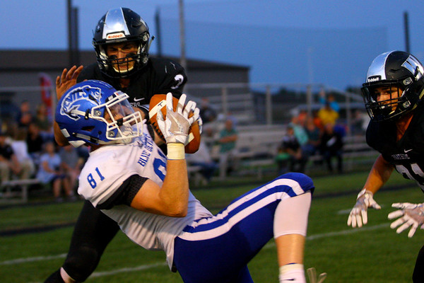 Tipton's Luke Stoker pulls in a pass for their second touchdown dispite coverage from Western's Tyler Knepley and Kitchel Gifford in Friday night football between Western HS and Tipton HS on Sept. 15, 2017. <br /> Tim Bath | Kokomo Tribune