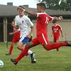 9-19-17<br /> Tri Central vs Taylor boys soccer<br /> Taylor's Wesley Tignor Borgani kicks.<br /> Kelly Lafferty Gerber | Kokomo Tribune