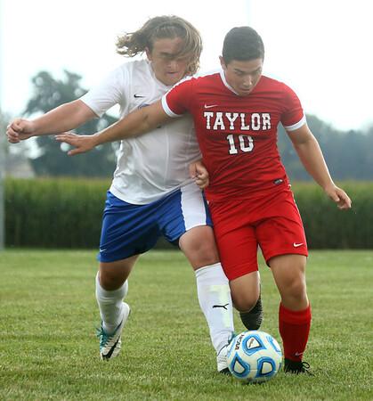 9-19-17<br /> Tri Central vs Taylor boys soccer<br /> TC's Tom Fennell and Taylor's Ken Kessler go after the ball.<br /> Kelly Lafferty Gerber   Kokomo Tribune