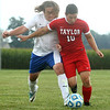 9-19-17<br /> Tri Central vs Taylor boys soccer<br /> TC's Tom Fennell and Taylor's Ken Kessler go after the ball.<br /> Kelly Lafferty Gerber | Kokomo Tribune