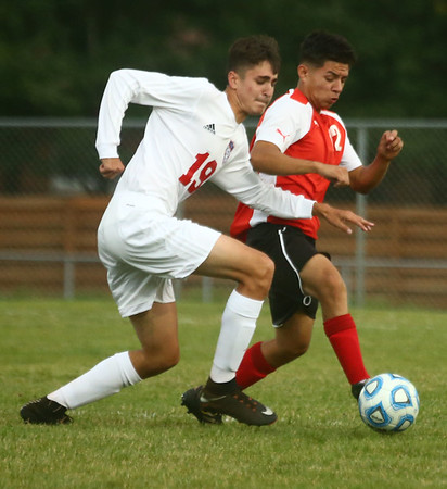 9-12-17<br /> Kokomo vs Logansport boys soccer<br /> Kokomo's Alec Barreira and Logansport's Genaro Cruz go after the ball.<br /> Kelly Lafferty Gerber | Kokomo Tribune