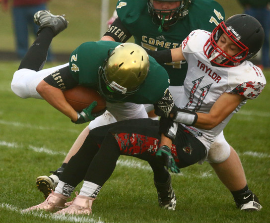 9-8-17<br /> Eastern vs Taylor football<br /> Taylor's Ricardo Espinoza takes down Eastern's Dakota Spencer.<br /> Kelly Lafferty Gerber   Kokomo Tribune