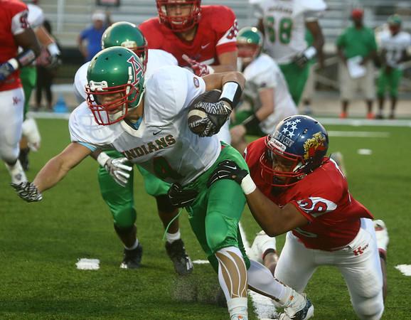 9-22-17<br /> Kokomo vs Anderson football<br /> Kokomo's Brody Smith tackles Anderson's Elijah Merida.<br /> Kelly Lafferty Gerber   Kokomo Tribune