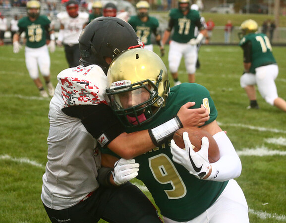 9-8-17<br /> Eastern vs Taylor football<br /> Braden Sparks runs the ball.<br /> Kelly Lafferty Gerber   Kokomo Tribune