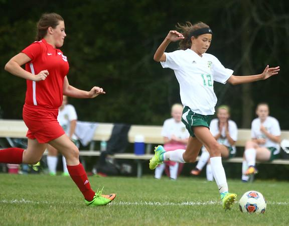 9-6-17<br /> Eastern vs Maconaquah girls soccer<br /> Eastern's Heidi Williams makes a kick.<br /> Kelly Lafferty Gerber | Kokomo Tribune