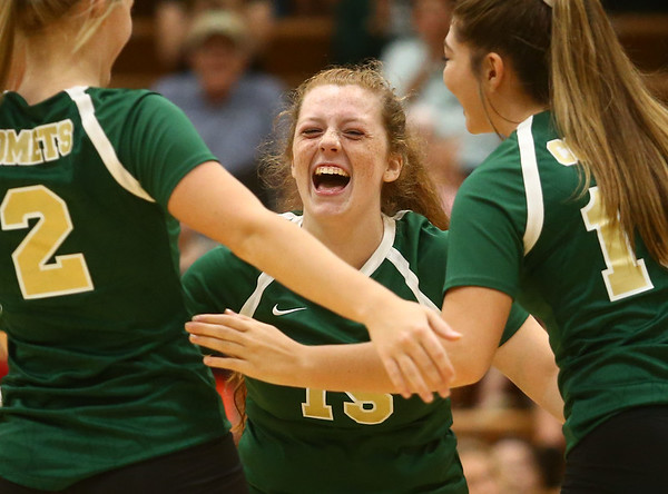 9-21-17<br /> Eastern vs Taylor volleyball<br /> Maci Weeks celebrates with teammates after an Eastern point.<br /> Kelly Lafferty Gerber | Kokomo Tribune