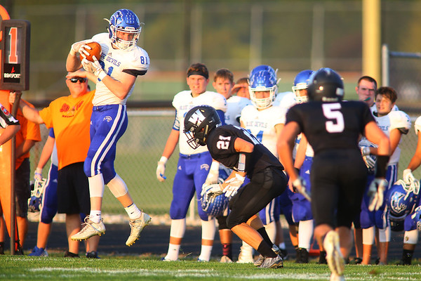 Tipton's Luke Stoker pulls in a pass with coverage from Western's Ktchel Gifford during the first quarter in Friday night football between Western HS and Tipton HS on Sept. 15, 2017. <br /> Tim Bath | Kokomo Tribune