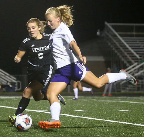 9-14-17<br /> Northwestern vs Western girls soccer<br /> NW's Oliva Hale goes for the kick as Western's Brooklyn Garber tries to block.<br /> Kelly Lafferty Gerber | Kokomo Tribune