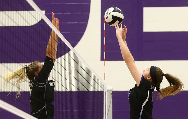 9-26-17<br /> Northwestern vs Western volleyball<br /> NW's Steph Burns hits it over the net.<br /> Kelly Lafferty Gerber | Kokomo Tribune
