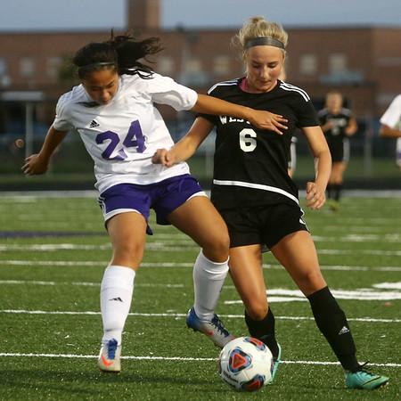9-14-17<br /> Northwestern vs Western girls soccer<br /> NW's Sarah Smith and Western's Sophie Weigt battle over the ball.<br /> Kelly Lafferty Gerber | Kokomo Tribune