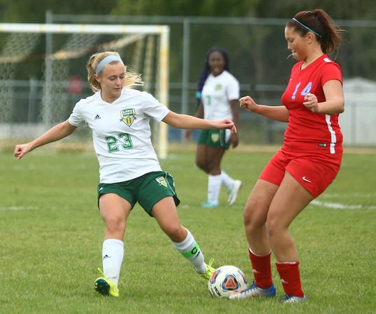 9-6-17<br /> Eastern vs Maconaquah girls soccer<br /> Eastern's Cassie Bryan kicks the ball away from Mac's Lilly Scheffler.<br /> Kelly Lafferty Gerber | Kokomo Tribune