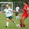9-6-17<br /> Eastern vs Maconaquah girls soccer<br /> Eastern's Cassie Bryan kicks the ball away from Mac's Lilly Scheffler.<br /> Kelly Lafferty Gerber   Kokomo Tribune