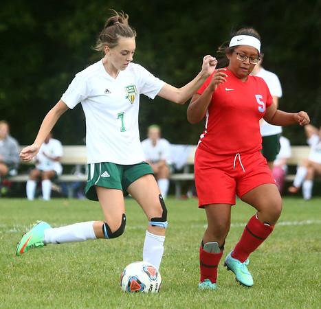 9-6-17<br /> Eastern vs Maconaquah girls soccer<br /> Eastern's Ellie Moore makes a kick before Mac's Tirzah Fye can block.<br /> Kelly Lafferty Gerber | Kokomo Tribune