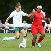 9-6-17<br /> Eastern vs Maconaquah girls soccer<br /> Eastern's Ellie Moore makes a kick before Mac's Tirzah Fye can block.<br /> Kelly Lafferty Gerber   Kokomo Tribune