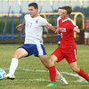 9-19-17<br /> Tri Central vs Taylor boys soccer<br /> TC's Nathan Mast gets control of the ball over Taylor's Clay Hight.<br /> Kelly Lafferty Gerber | Kokomo Tribune