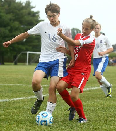 9-19-17<br /> Tri Central vs Taylor boys soccer<br /> TC's Alexander Porter and Taylor's Logan Bass go after the ball.<br /> Kelly Lafferty Gerber | Kokomo Tribune