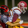 The Berries Oscar Grimaldo (21) wraps up the Mavericks Kelden Tyson (85) on a pass play in the second half. Logansport fell to McCutcheon by a score of 21-0 on Friday night.