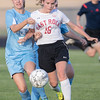 Page's Lyndesy Knowles and Sydney Thayer battle with Leslie Wood