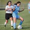 Page's Laura Rivera and Norma Morris battle for control of the ball.