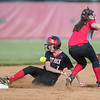 Meredith Dean steals second and is hit by the ball after a failed catch.