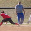 Serenity Bishop stretches for the ball to make the play on a hit from Brianna Madden