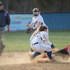 Meredith Dean slides in to second base after a wild toss to Danielle Soard
