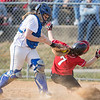 Haileigh Lutz tags Haley Shifflett out as she attempts to slide in to home plate