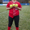 Serenity Bishop poses after the game with her three home run balls.