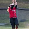 Jaclyn Gooden catches a fly ball from Kristen Fletcher