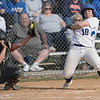 Haileigh Lutz leans back as a high ball flys by in front of her