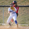Meredith Dean beats the play at first base as Kristen Fletcher waits on the ball