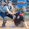 Booke Hensley slides in to home but is tagged out by Page's Alicia Campbell