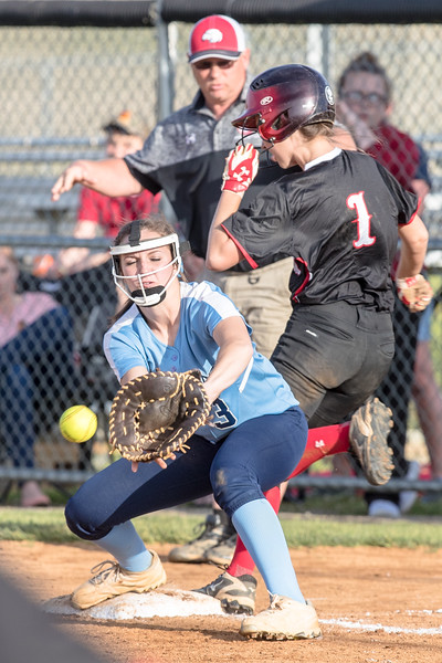Meredith Dean beats the ball to first base