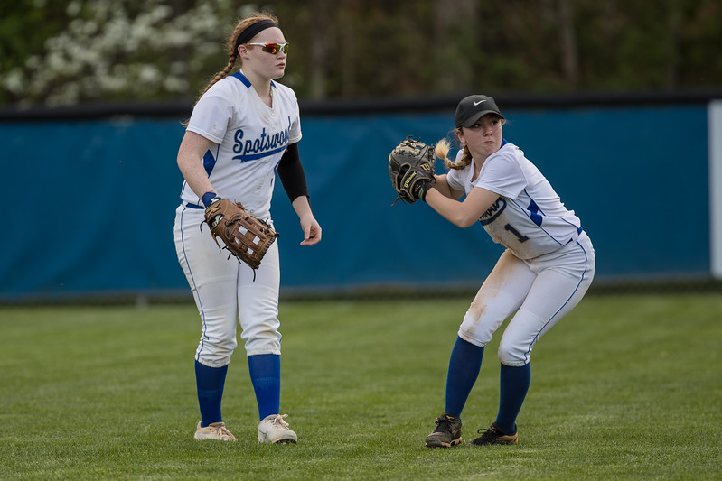 Kelsi Rhodes picks up a ball batted to center field by TA's Cana Davis