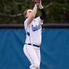 Taylor Carpenter catches a fly ball to center field batted by Carley Davis