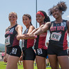 The girls 4x100 relay team pose with their batton after winning the state title