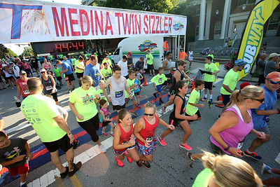 AARON JOSEFCZYK / GAZETTE Kids take off for the start of the fun run during the Medina Twin Sizzler event on Tuesday.