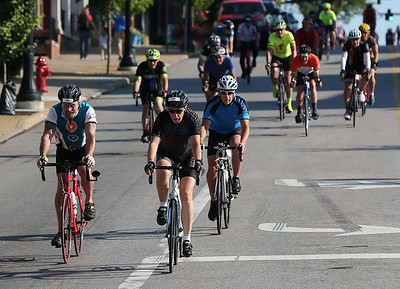 AARON JOSEFCZYK / GAZETTE Bikers make their way down South Court street at the start of their 26-mile race during the Medina Twin Sizzler event held Tuesday.
