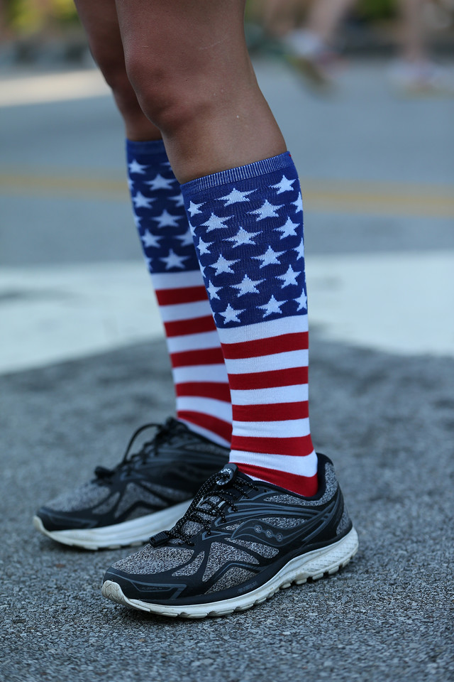 AARON JOSEFCZYK / GAZETTE One runner shows patriotic socks Tuesday during the Medina Twin Sizzler races.