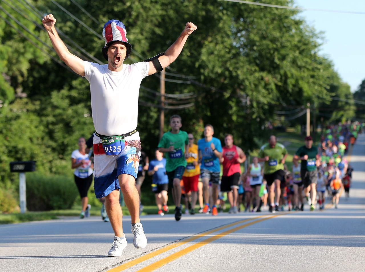 AARON JOSEFCZYK / GAZETTE Kyle Goodwin reacts as he runs during a 5-kilometer race at the Medina Twin Sizzler event held Tuesday.